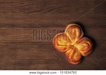 Yellow bun on a dark wooden background