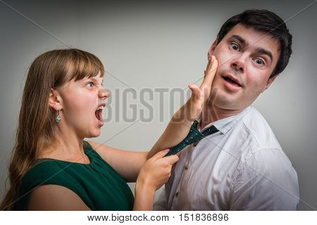 Angry woman giving a slap - domestic violence