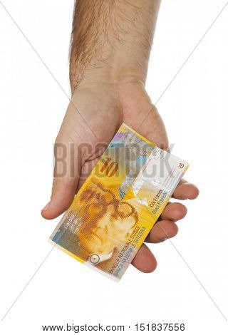 Man hand giving 10 swiss franc banknote isolated on white background