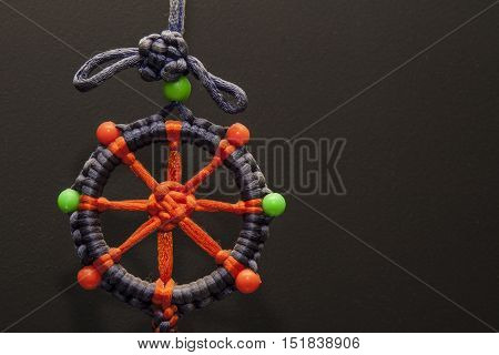 Dreamcatcher amulet on a black background Multicolored