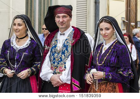 CAGLIARI, ITALY - May 1, 2014: 358th Religious Procession of Sant'Efisio - Sardinia - group of people in traditional Sardinian costume