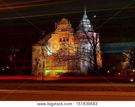Bus and villa. Lodz, Poland February 21.2015Blurred motion evening city bus in Lodz, against the background of the Civil villa (1903-1904) Reinchold Richter. Currently Rectorate University of Lodz.