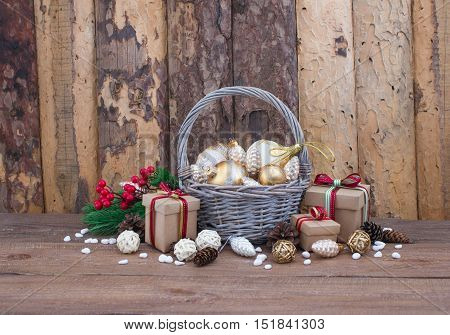 Christmas or New Year background: fur-tree branches, colorful glass balls, decoration and glittering stars on wood background