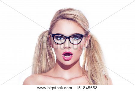 Sexy smart blonde wondering woman in glasses with double pigtails isolated on white