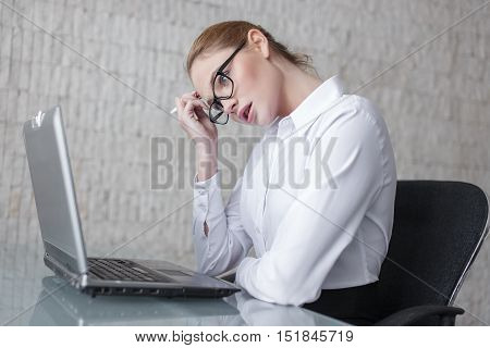 Blonde financial analyst woman worry about results in office with laptop