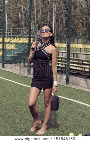 She Goes Barefoot On The Grass Of A Tennis Court