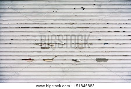 White painted metal stripes background grunge texture with old paint flakes off over time
