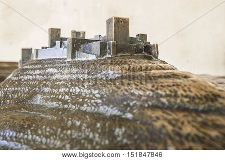 Historical reenactment on Bronze scale model of Alhambra Palace Spain
