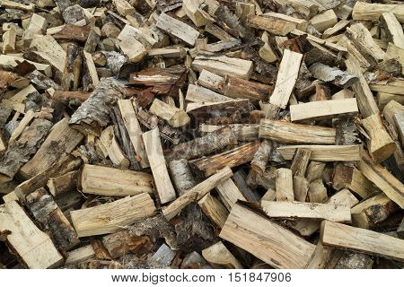 Firewood pile of wood cuttings for heating
