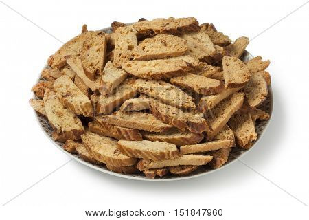 Dish with traditional Moroccan festive fekkas cookies on white background