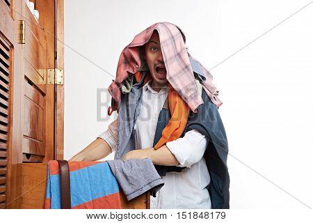 Man With Panic Next To Wardrope