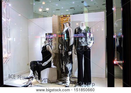 Saint-Petersburg, Russia - May 16, 2006: night shop window with women dressed mannequins