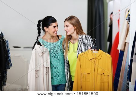 Smiling women shopping