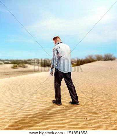 Injured businessman in the desert