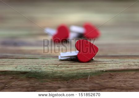 Wooden clothes pins with red hearts beautiful romantic valentines day decor