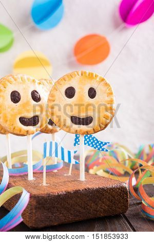 Childrens party background. Homemade shortbread cookies on stick called pie pops.