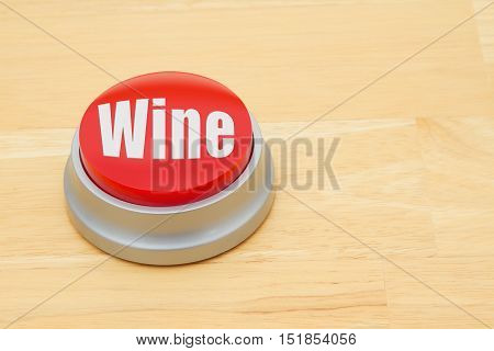 A Wine red push button A red and silver push button on a wooden desk with text Wine