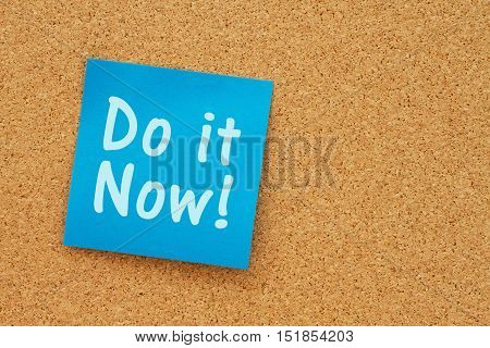 A reminder to do it now message Bulletin board with a blue sticky note with text Do it Now