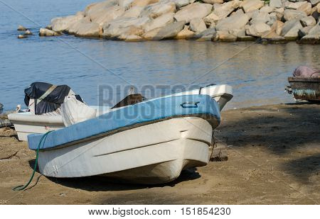 White blue fishing boat at Manzanillo beach. Mexico