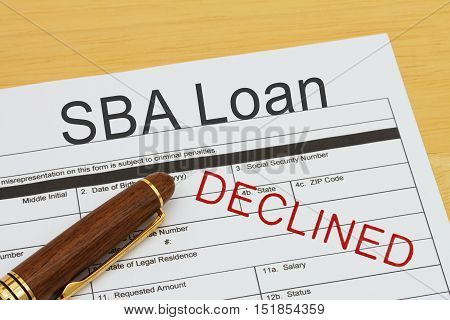 Applying for a SBA Loan Declined SBA Loan application form with a pen on a desk with an declined stamp