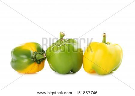 Yellow And Green Peppers Isolated On A White