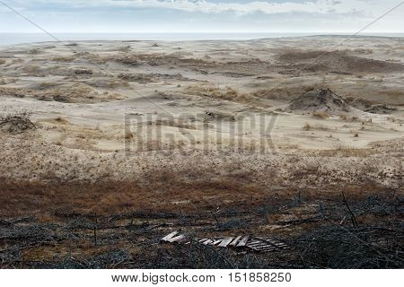 Sand dunes of the russian part Curonian Spit in february. The Curonian Spit is a 98 km long curved sand-dune spit that separates the Curonian Lagoon from the Baltic Sea coast. It is a UNESCO World Heritage Site.
