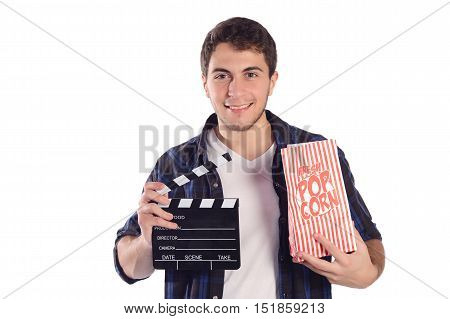 Portrait of a young handsome man with popcorn and clapper board. Isolated white background.
