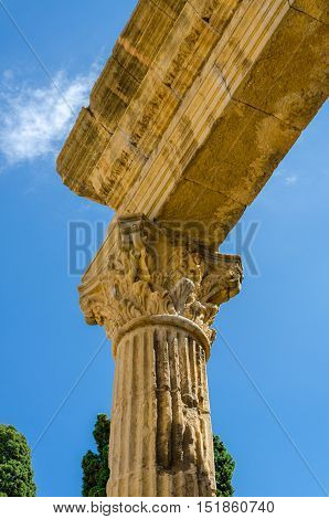 Detailed view on roman column construction on sky background in Tarragona, summer Spain