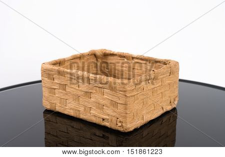 Wooden Basket Weave on reflect table on white background