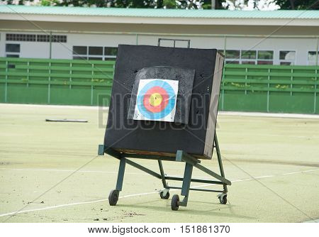 Archery target rings during an archery competition. Green grass.