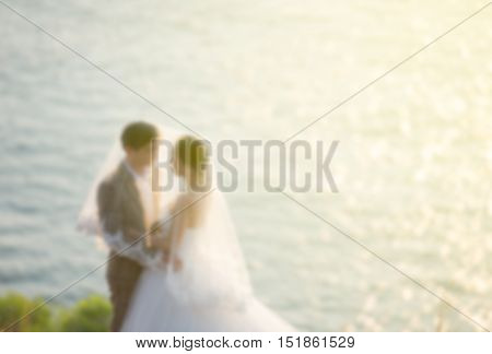 Blurred Lover eye contact side the sea at sunset sea