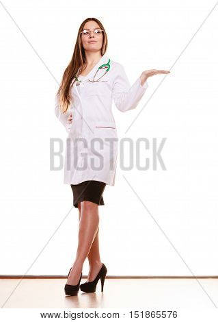 Woman medical doctor with stethoscope wearing white coat holding empty palm hand for copyspace. Professional health care advertisement.