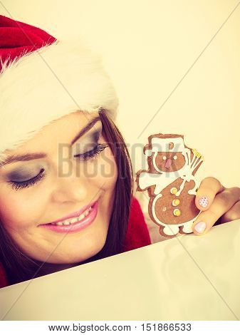 Woman Santa Claus Hat With Gingerbread Cookie. Christmas