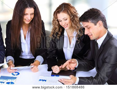 business technology and office concept - smiling female boss talking to business team