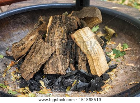 Pile of firewood and coal ready for kindling of a fire