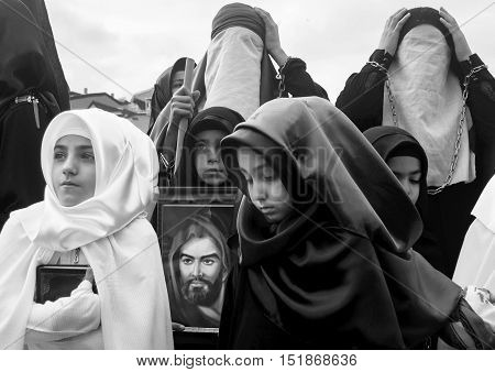 Istanbul Turkey - November 3 2014: Mourning of Muharram in Turkey. Day of Ashura. A Universal Ashura Mourn Ceremony was held in Istanbul to commemorate the martyrdom of Husain ibn Ali the grandson of the Prophet Muhammad and his 71 friends.