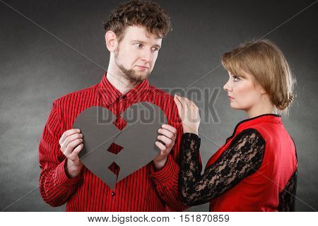 Divorce and separation concept. Couple have serious crisis in relationship. Husband and wife leave each other after argument. People with broken black heart.