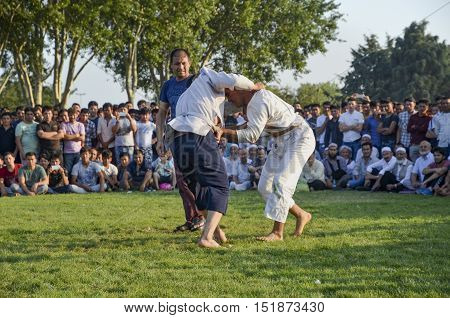 Istanbul Turkey - July 31 2016: Central Asian Turkmen wrestling. in Zeytinburnu district of Istanbul Turkmen wrestling sports events held in the coastal meadows. Turkmen Uzbek Afghan Turkish Turkmenistan Kazakhstan Turkey and other Central Asian youth are