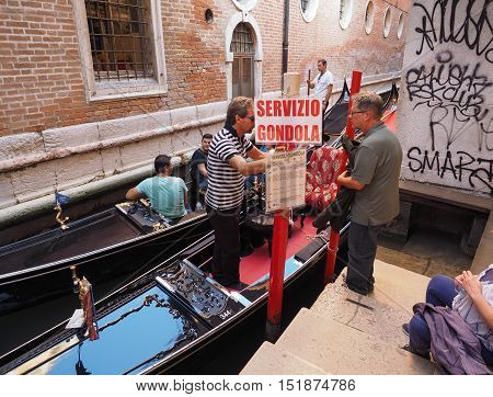 Gondola Rowing Boat In Venice