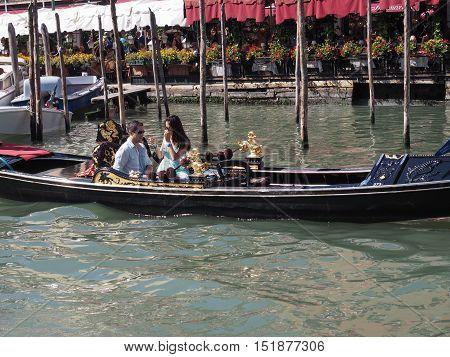 Gondola Rowing Boat In Venice