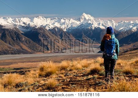 A Woman Hiker Looks Towards The Southern Alps. Hakatere Conservation Park, Canterbury, New Zealand