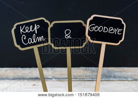 Keep Calm And Goodbye Message Written With Chalk On Mini Blackboard Labels