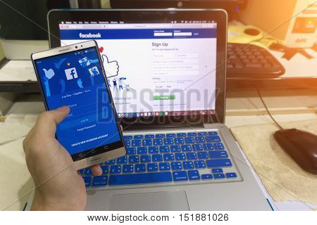 Close Up Screen In A Man Hand Holding Screen Shot Of Android Device With Social Network Service Face