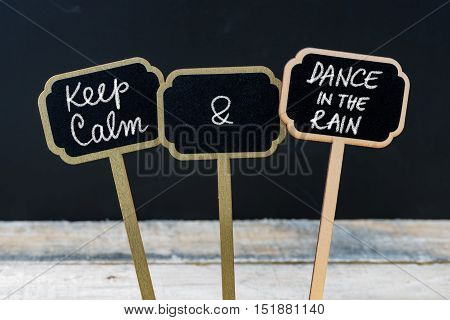 Keep Calm And Dance In The Rain Message Written With Chalk On Mini Blackboard Labels