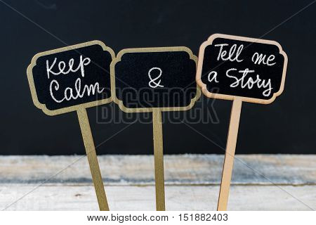 Keep Calm And Tell Me A Story Message Written With Chalk On Mini Blackboard Labels