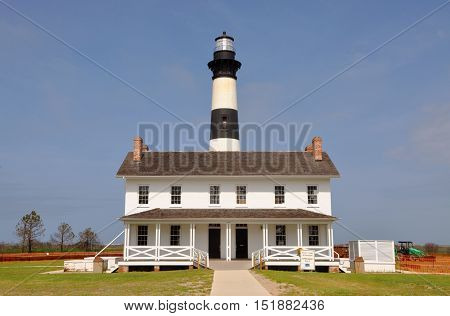 Bodie Island Lighthouse and keeper's quarters in Cape Hatteras National Seashore, south of Nags Head, North Carolina, USA.