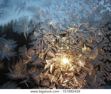 Frosty Pattern On Winter Window And Sun