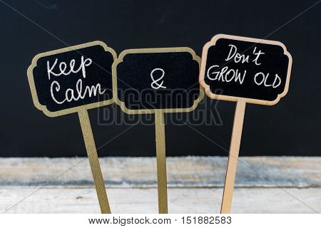 Keep Calm And Do Not Grow Old Message Written With Chalk On Mini Blackboard Labels