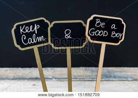 Keep Calm And Be A Good Boy Message Written With Chalk On Mini Blackboard Labels
