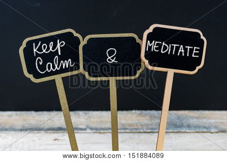 Keep Calm And Meditate Message Written With Chalk On Mini Blackboard Labels